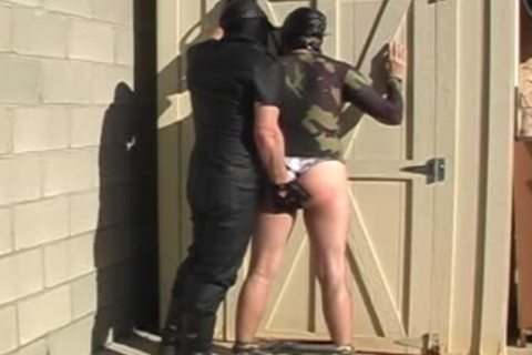 Masked males disrobe And nail Each Other outside