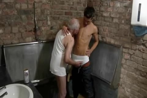 nice Looking old man & young man engulf Each Other In A Public