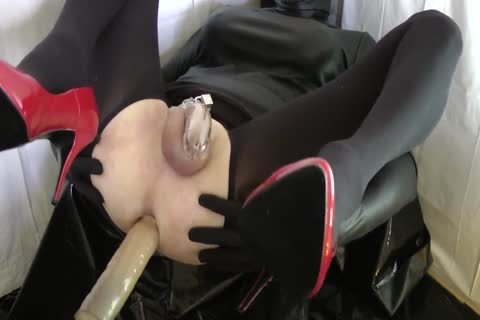 Sissy With Red Heels Is plowed In A Chastity Belt