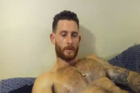 built chap With Oiled Body Masturbating With His Hard rod