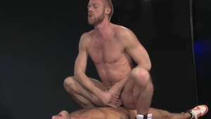 Raging Stallion: Driver Shawn Wolfe in clamps jerks off