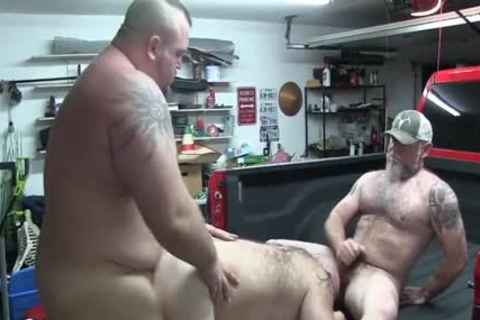 males pounding On A Truck