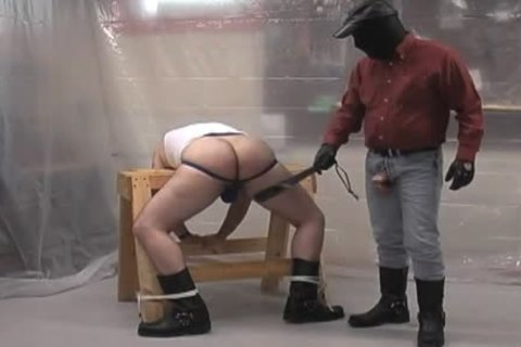 Masked slavemaster undressed ploughs his subordinate